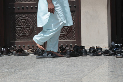 Afternoon prayer time at the Grand Mosque in Dubai.  Shoes and non-Muslims are not permitted beyond the front door.