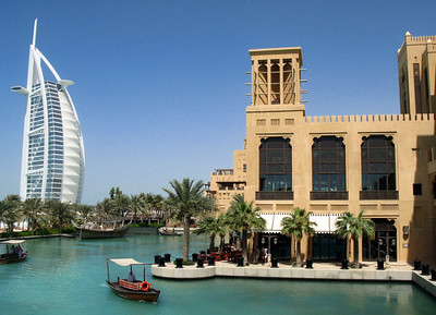 Dubai Old & New: the ultra-modern Burj Al Arab hotel to the left and the more traditional Al Qasr Hotel opposite.