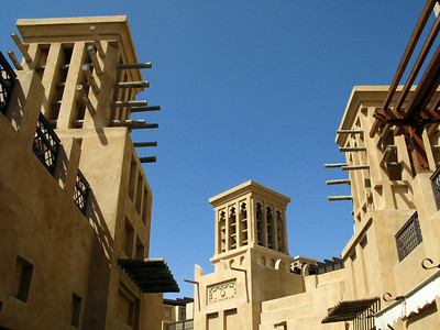 An upward view from a courtyard within the Madinat Jumeirah Souk, Dubai looking at traditional UAE wind towers design.