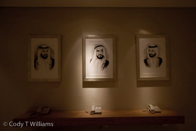 Lighted portraits of Sheikh Khalifa, Sheikh Zayed, and Sheikh Mohammed above the call center of the Ibis Hotel in Dubai, United Arab Emirates (UAE), May 25, 2009. /© Cody Williams.