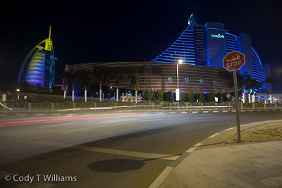 Cars whiz by the night lights of the Jumeirah Hotel of Dubai, United Arab Emirates (UAE), May 25, 2009. /© Cody Williams.