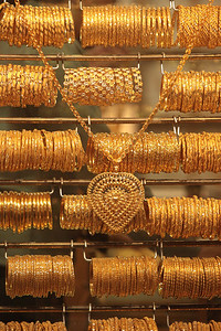 A storefront in the Gold Souk.  Most of the gold is 22-24K.  Each piece is weighed and then sold by the gram, subject to price negotiation.  A saavy buyer will take the initial price and bargain up from 50-60%.