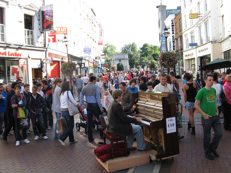 Another street performer with a piano.