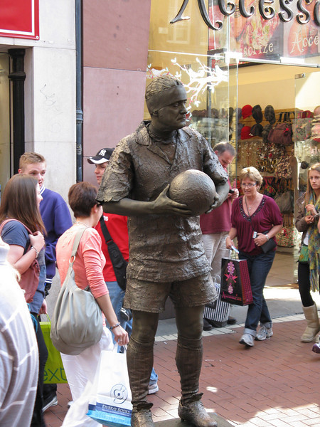 A living statue. Every now and then he would blink or move.