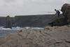 fishermen along the rock coast of kilkee