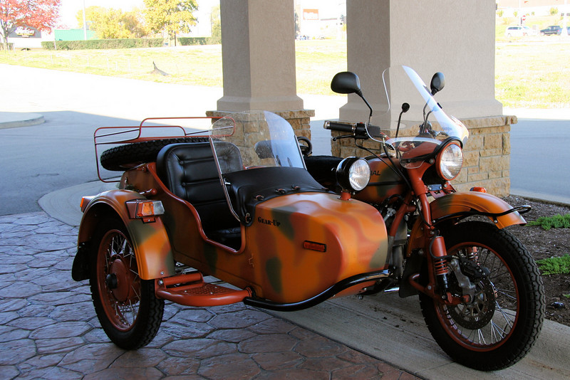 "Paul saw this bike out the front doors of the motel. He thought it was someone's lovingly restored WW II era baby. On getting up close enough for pictures I discovered it was a <a href=""http://www.imz-ural.com/"" target=""_blank"">Ural</a>. It <i>is</i> a Russian make but it was disappointing to find you can buy them all over the states. However, Ural is one of the few remaining manufacturers of sidecar bikes."