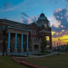 Duluth GA City Hall.  I came to the square area of Duluth to photograph the Memorial Day flags the city fathers place every year and as the sun set over the City Hall building the sky was brilliant with color.