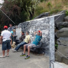 Visitors rest at top of Baldwin Street (World's steepest street) in Dunedin, New Zealand.