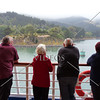Cruise ship passengers looking out at Port Chalmers in Dunedin, New Zealand.