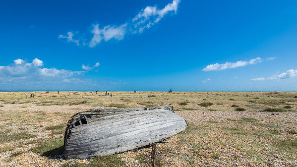 An upside down, broken boat in Dungeness. Abandoned and neglected.