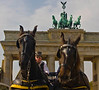 """This is one of my favorites.....I happened to be sitting on a curb as these horses were coming at me and I just shot a photo """"hoping"""" to align it with the Quadriga on the top of the Gate.  They could not have posed any better."""
