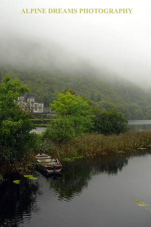 Misty view from boat of Kylemore Abbey