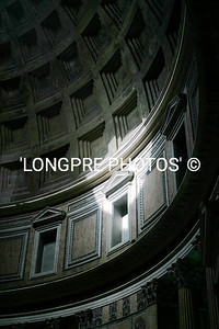 Inside PANTHEON.  sun spot from open circle top of roof.