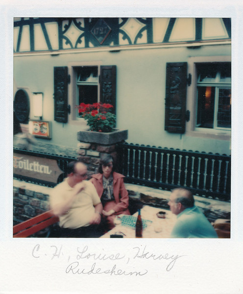 C.H., Louise, and Harvey having lunch in Rudesheim