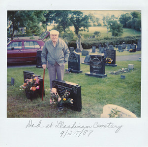Dad visiting his parents' grave in Llandinam Cemetery