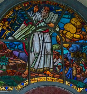 Moses receiving stained glass windows.