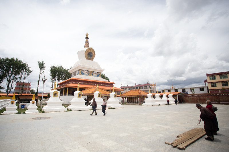 Tibetan men pray outside of the white temple in the town of Lithang in Sichuan, China.