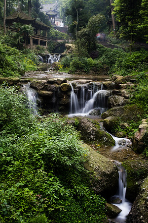 A small waterfall outside a temple on Qingcheng Mountain Taoist holy site in Sichuan, China.
