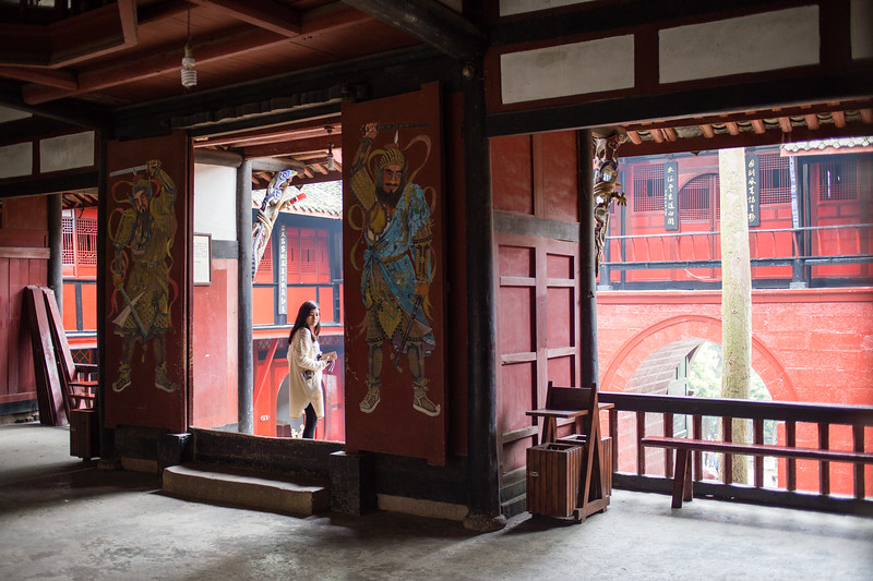 A lone tourist wanders through the door of a Taoist temple on Qingcheng Mountain near the city of Chengdu in Sichuan, China.