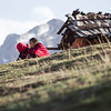Two monks sit together on a hillside overlooking the town of Langmusi in Sichuan, China.