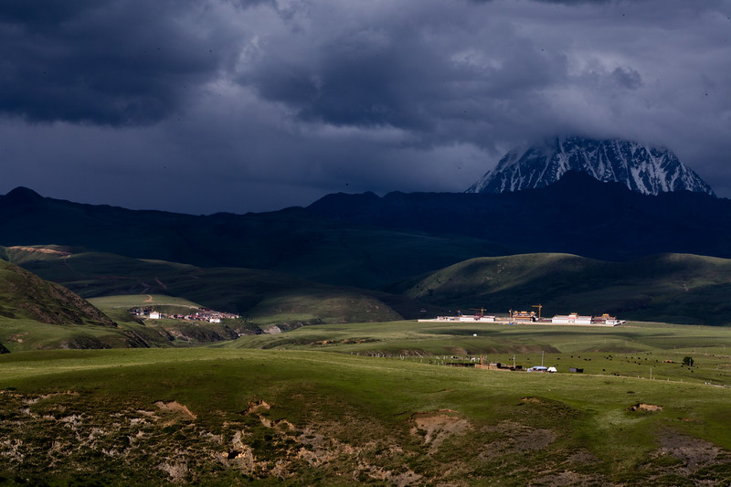 Dark clouds over a monastic school near the town of Tagong in Sichuan, China.