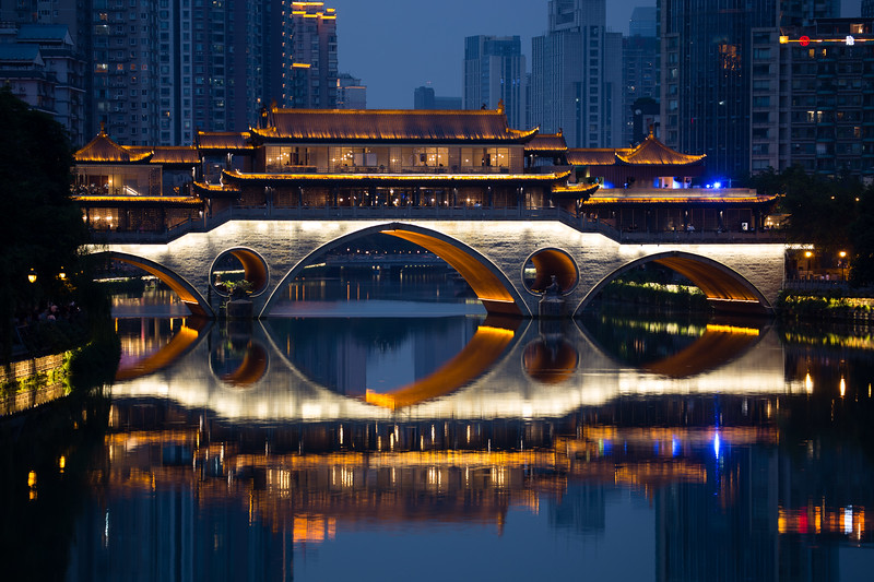 Skyline reflections by the Anshun Long Bridge in Chengdu, Sichuan, China.