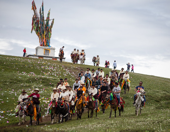 Riders return from the finish of the Tagong Horse Festival in Tibetan Sichuan.