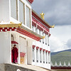 Monks stand in the doorway of a monastic school near the town of Tagong in Sichuan, China.