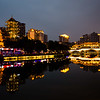 Skyline reflections by the Anshun Long Bridge in Chengdu, Sichuan, China.
