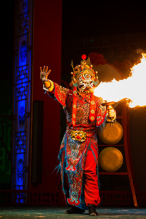Fire-breathing face-changer at a performance of Sichuan Opera in Chengdu, China.