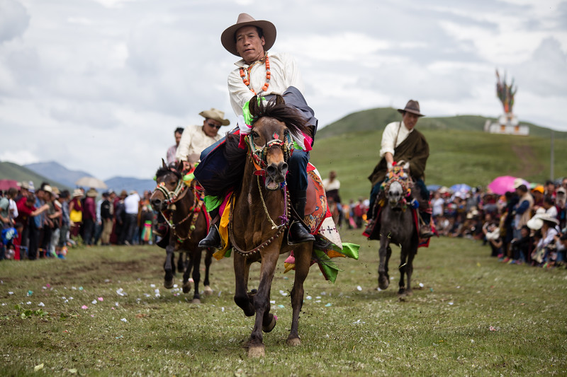 Tibetan riders in a horse festival near the town of Tagong in Sichuan, China.