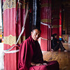 A lone monk sits at a temple in the town of Xiangcheng in Sichuan, China.