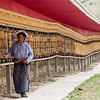 A Tibetan Buddhist pilgrim makes a kora of prayer wheels outside the town of Songpan in Sichuan, China.