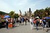 Tourists walking across Charles Bridge Prague