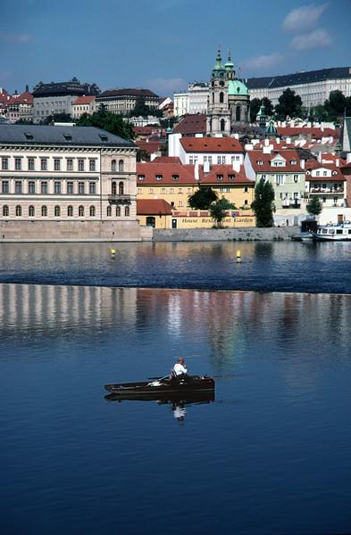 Fishing in the Vltava River Prague Little Quarter in background