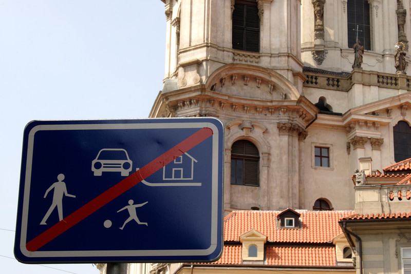 Street sign in front of Church of St Nicholas Prague