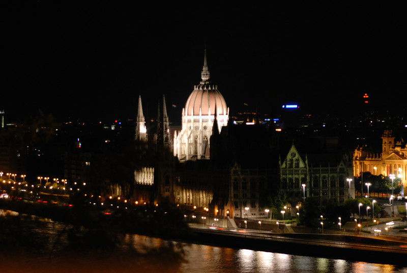 Orszo'gha'z : Parliament Building at night from across the Danube on the Buda side at a cafe at Buda Castle. Budapest Hungary