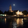 The moon and other lighting reflect of Kriza Bay in front of the Franciscan Monastary in Hvar, Croatia.