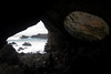 View from a volcanic cave. Note ancient painting on room at right. (Made visible by Photoshop)