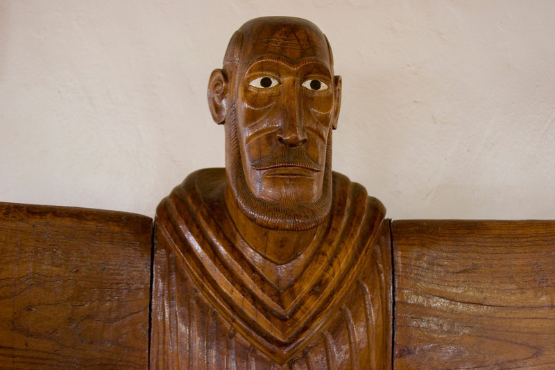 The early 20th Century priest. Note moai-like eyes.