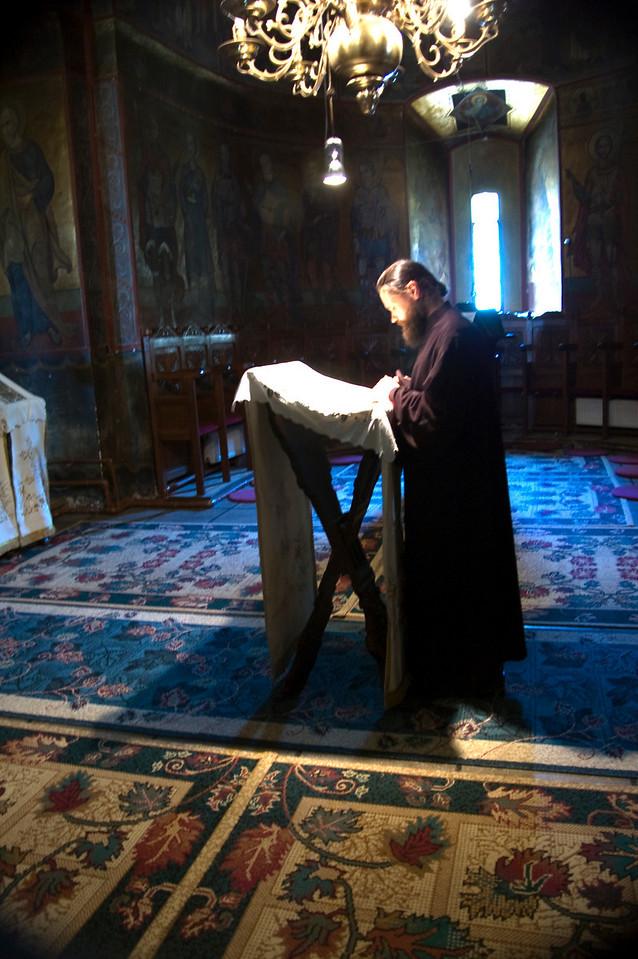 Monk praying inside Caldarusani Monastery