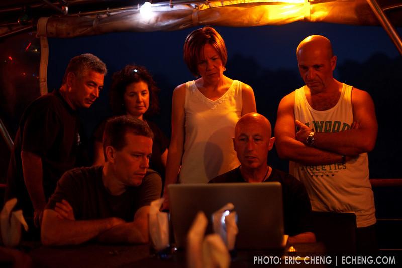 George, Deb, Jennifer, Julian, and Brian watch Phil work