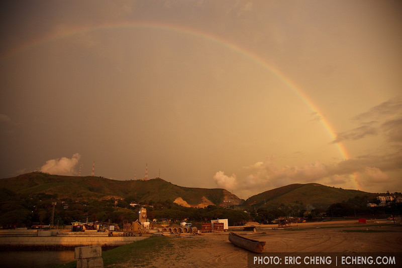 A dusk rainbow appears and remains in the sky even after the sun has set. Port Moresby, Papua New Guinea