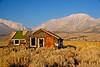 Deserted cabins set against a spectacular background