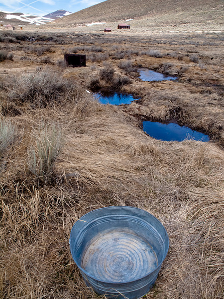On the outskirts of Bodie there is a lot of debris and many of these old galvanized tin tubs.  I just loved the progression from it to the puddles to the slice of sky.  Looking at it now I wish I'd moved the tub about 8 inches inward.  Ah well.