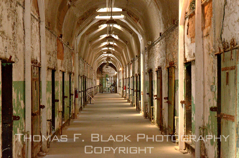 "Entire gallery devoted to photos taken inside Eastern State Penitentiary, Philadelphia, in May 2012. Although closed in 1971 after decades of service, to this day the facility remains open to the public daily for self-guided tours. Cameras -- including flash and tripods -- are permitted. Eastern State is notable as the first pokey in which Al Capone served time (for evasion of federal taxes), the 1945 escape of notorious bank robber Willie Sutton (recaptured shortly after emerging from the tunnel he had laboriously dug), and the bloody riot of 1961 in which a number of inmates and guards were killed. The history is as fascinating as is the architecture.  <a href=""http://www.easternstate.org"">http://www.easternstate.org</a>"