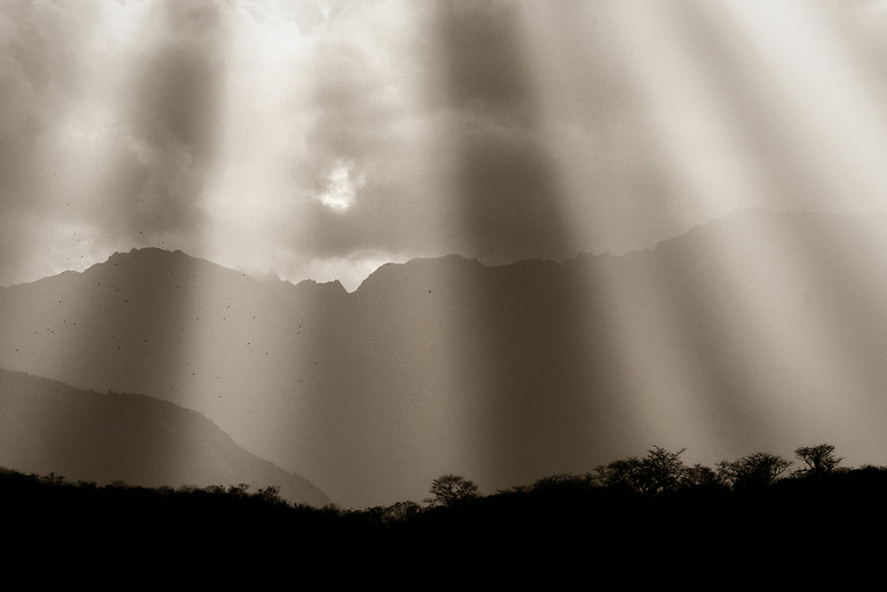 God Beams of light luminate the Andean mountain sky