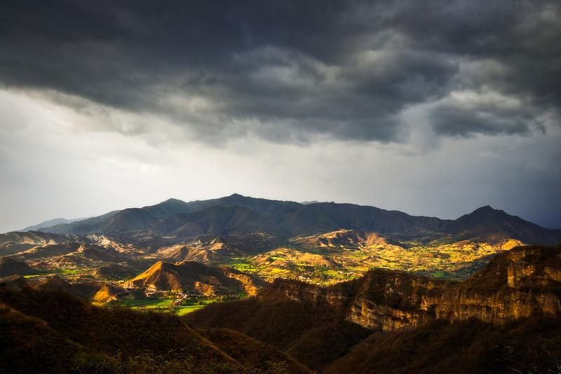 Golden light sweeps across an Andean mountain valley near, Malacatos, Ecuador.