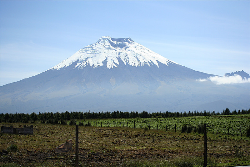 I stopped for this photo of Cotopaxi about an hour outside of Quito in Ecuador, the fence in the foreground and the piece of garbage on it have always lured me to remove it