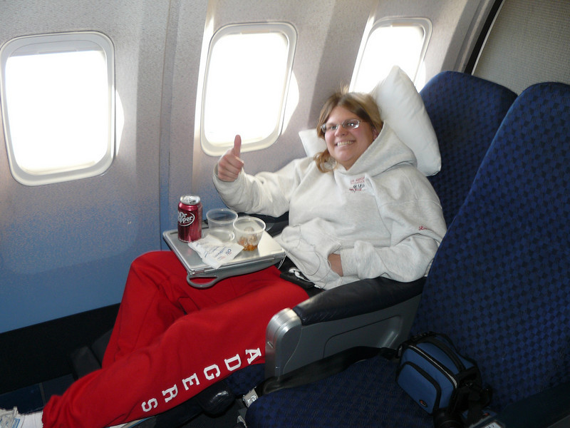 They moved us up to reclining seats for the flight from O'Hare to Miami. Plus they were in their own little cabin in the middle of business and coach, and there was a curtain that we could have used to seclude ourselves from everyone else.
